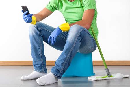 hardworking: Man sitting on bucket and having break during housework