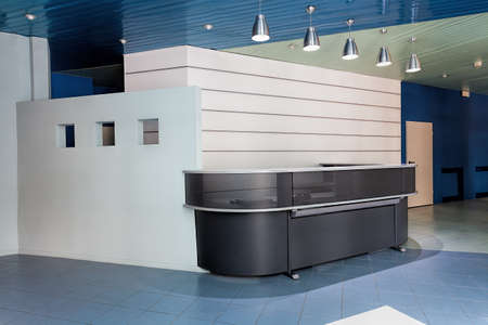 Contemporary reception counter in a hallway of company photo