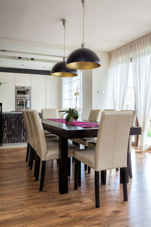 Urban apartment - Wooden table in a dining room photo