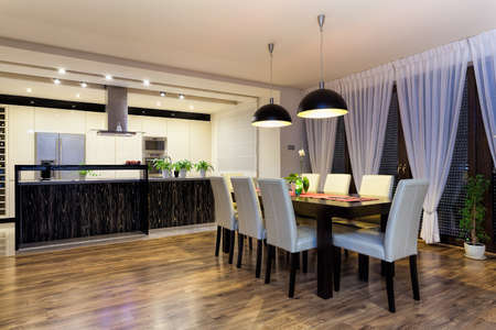 dining room: Urban apartment - Spacious kitchen with wooden black table