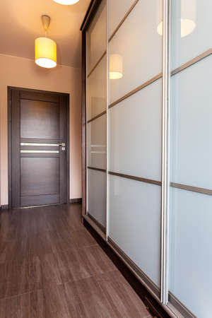 lamp house: Urban apartment - door in corridor and huge wardrobe Stock Photo