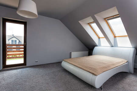Urban apartment - modern bedroom on the attic photo