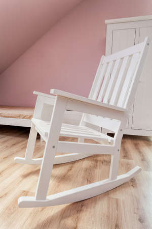 Urban apartment - white rocking chair in girl's room photo