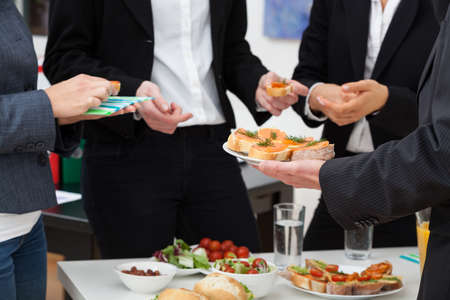 catering service: Managers meeting with healthy food in office