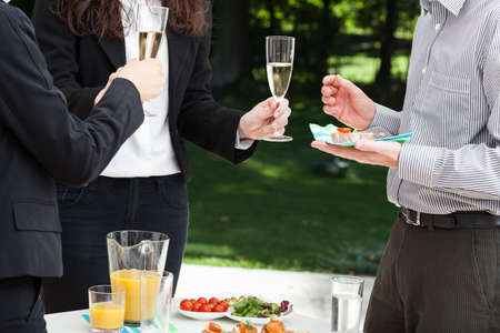 business dinner: Business people are celebrating the succes in the garden Stock Photo