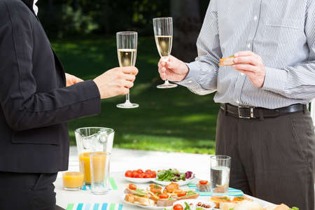 Business people are celebrating the success in the garden Stock Photo - 23835639