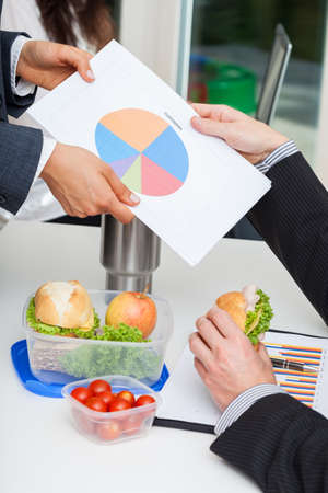 Managers are discussing about finances during the morning meal break Stock Photo - 23835740