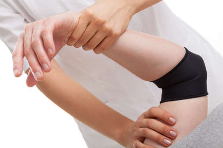 elbow band: Physiotherapist helping in elbow exercises of tennis player