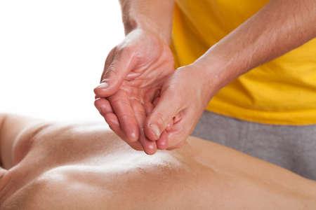 Physiotherapist preparing hands to professional health massage photo
