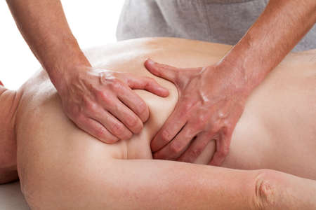 masseur: Masseur  applying advanced massage techniques in order to relax patient