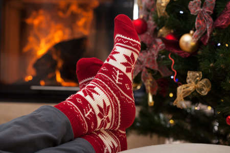 Relaxation after christmas in cozy interior with fireplace Stock Photo - 23835960