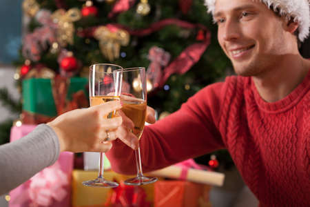 Couple making a toast with champagne during christmas photo