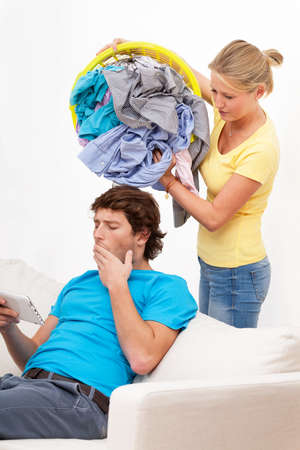 household chores: Woman tired of a housework and his lazy man Stock Photo