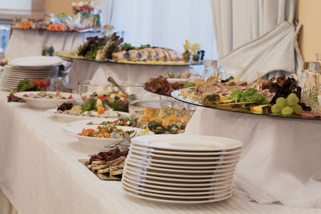 Appetizers and salads on luxury wedding buffet photo