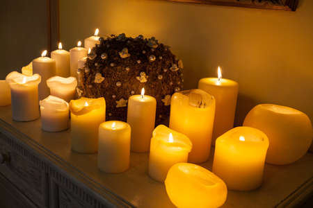 Centrepiece: Plenty of lighted candles and decoration on commode