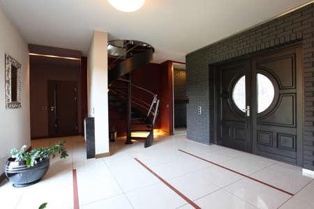 Spacious modern interior and huge wooden door Stock Photo - 24026076