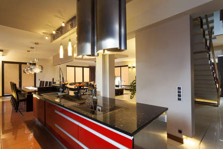 Black and red counter top in kitchen