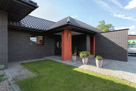 storied: Entrance to a modern luxury house with brick wall Stock Photo