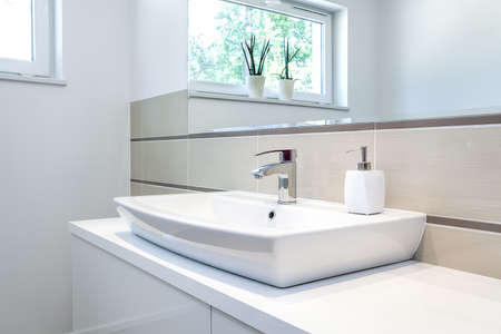 vessel sink: Bright space - a silver tap in a white bathroom