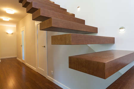 Bright space - brown wooden steps in a modern apartment photo