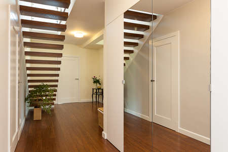 Bright space - an elegant spacious room with wooden stairs photo