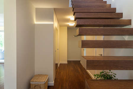 Bright space - a closeup of modern wooden steps photo