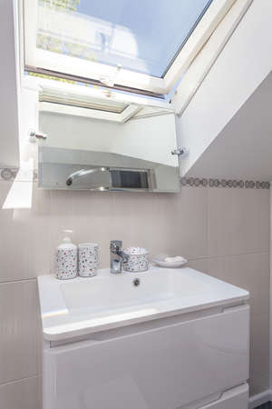 Bright space - a white sink and a mirror photo