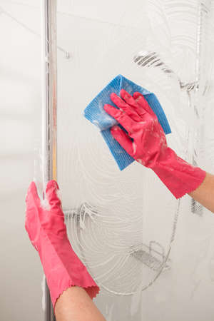 A man polishing a shower with a wet rag Stock Photo - 24026175