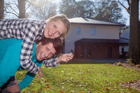 Happy couple with a keys for a new luxury house photo