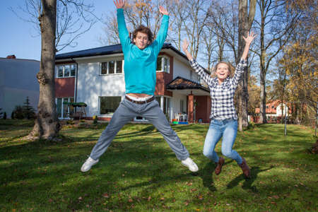 Young people in love beeing happy because of the new house photo