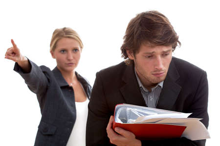 angry boss: Angry boss and poor worker with heap of papers Stock Photo