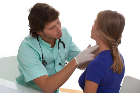 Endocrinologist testing a thyroid of young woman
