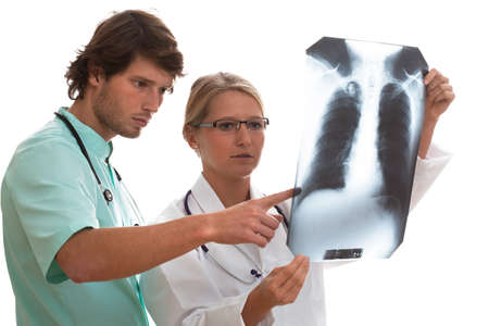 Pulmonologist and general surgeon watching x-ray scan before surgery photo