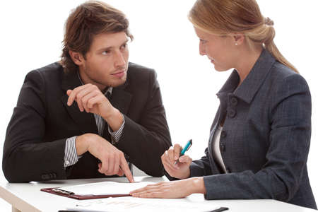 persuade: Businessman persuading his financial partner to signing a contract