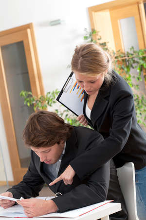 workmate: Helpful female workmate and busy man