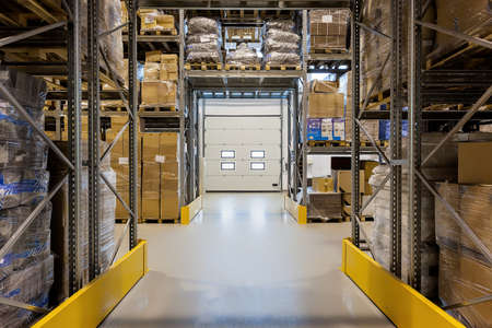 Entrance to a huge warehouse with metal rack Imagens