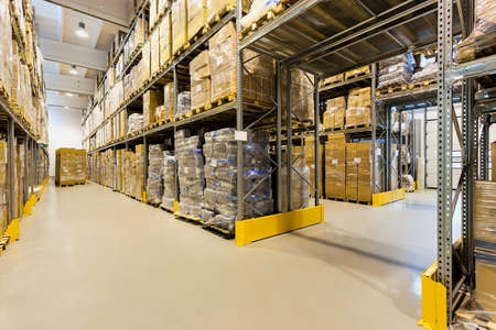 distribution box: Interior of a huge spacious warehouse with carton boxes Stock Photo