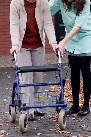Old person learning to walking with walker photo
