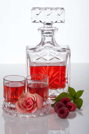 crystal glass: Infusion of raspberry fruits steeped in alcohol