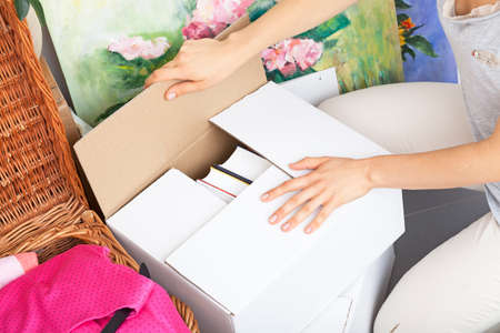 Woman finish packing and leaving boxes ready to moving photo