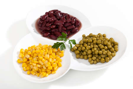 heathy diet: Corn,peas and beans on white bowls on white isolated background Stock Photo
