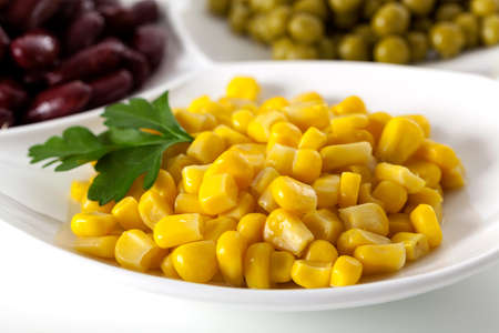 heathy diet: Close up of yellow corn on white isolated background