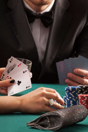 poker game: Poker game in casino, couple with cards