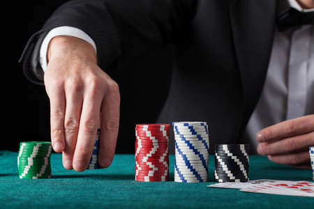 croupier: Croupier chip tricks on green casino table Stock Photo