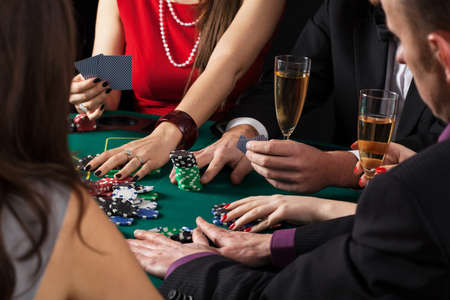 Poker game in progress, people sitting at casino table photo