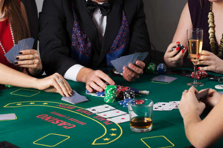 Rich people gambling in casino, poker game photo