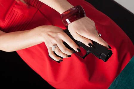 reloading: Woman in red dress reloading gun before a shoot