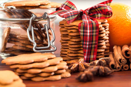 Christmas baking, heap of tasty gingerbread and spices photo