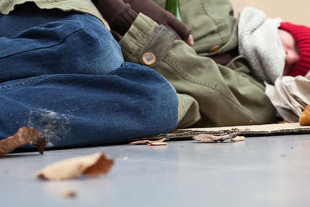 Homeless lying on the cardboard on the gorund Stock Photo - 24368886