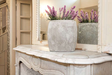 mantelpiece: Vintage mansion - a lavender vase on a white mantelpiece